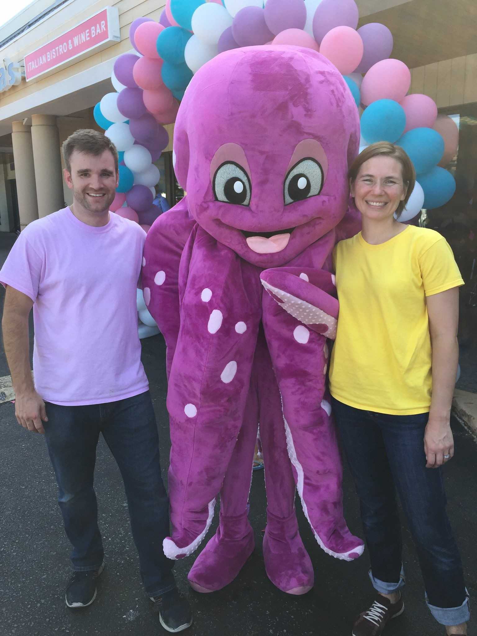 Owners Mike and Lindsay McEwen with Gary, the Mascot